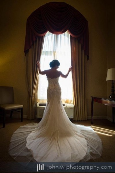 Silhouette photo of bride getting ready at the nearby hotel on wedding day